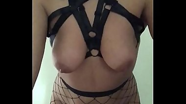Naughty milf plays with her toys and shaved pussy in fishnet