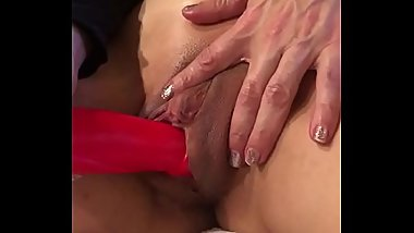 Big dildo in a tight shaved pussy