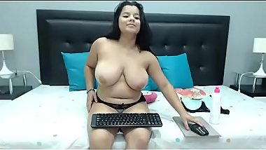 Sexy young Latin girl with her chubby and big tits on cam