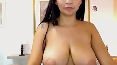 Lovely Latin milf shows off huge tits