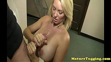 Glamour milf tugs young cock over her bigtits